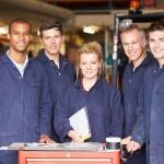 Portrait Of Staff Standing In Engineering Factory